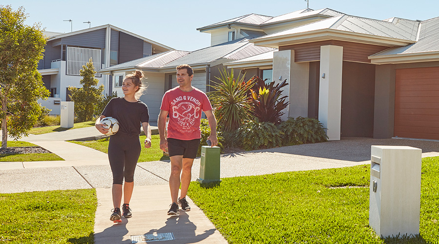 Residents walk to the park at Stockland's Bells Reach community on the Sunshine Coast (Qld)