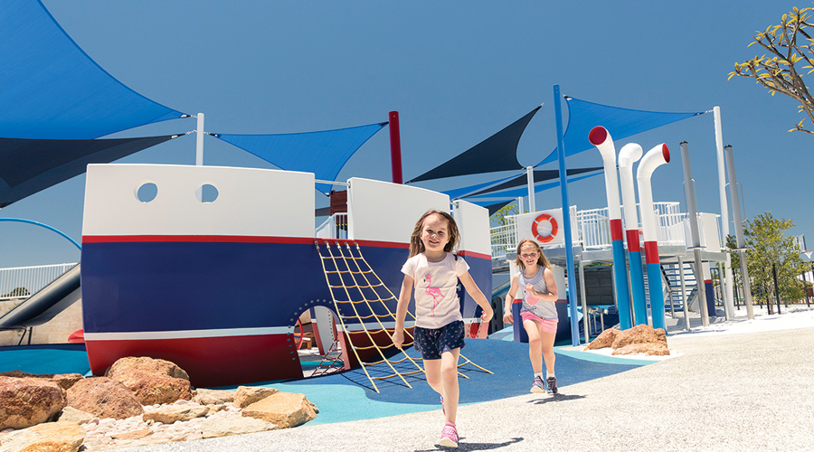 Children enjoy the inclusive Shipwreck Park at Stockland's Sienna Wood residential community in Hilbert, WA.