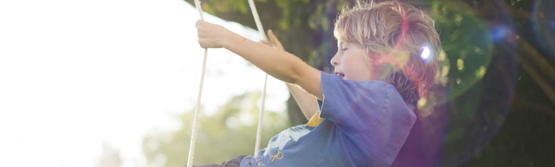 residential boy on swing 1920x580