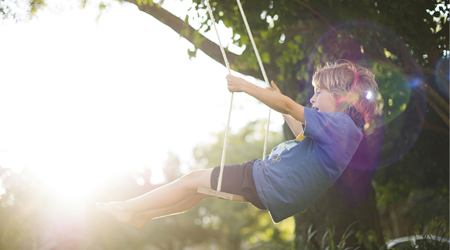 residential boy on swing 900x500