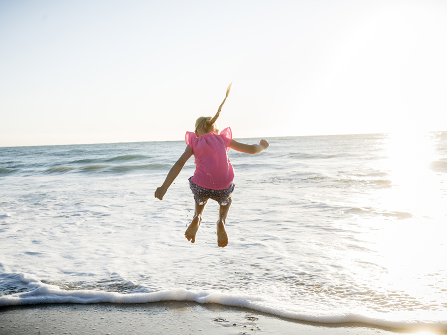 Amberton girl jumping on beach 900x675