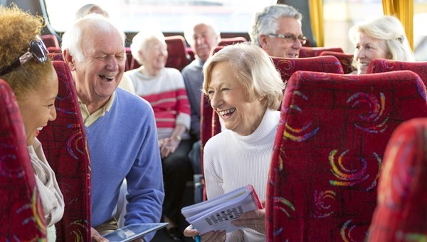 Laughing people on a bus