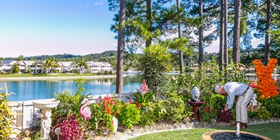 pine lake village external garden with water 1920x580
