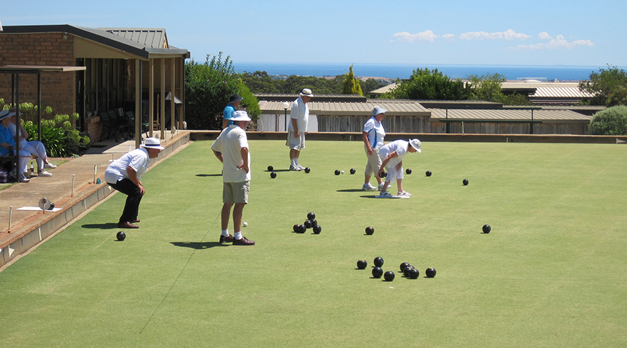 A group of residents at a retirement village enjoy a game of lawn bowls