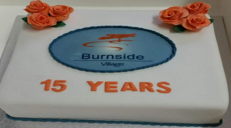 Burnside celebrates their 15th birthday with a beautifully decorated cake