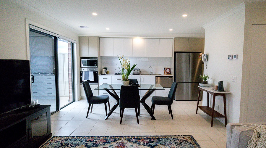 The kitchen and dining area of a fully furnished Wren villa at Mernda Retirement Village