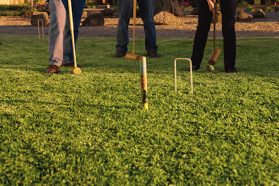 People holding croquet clubs on croquet lawn at Selandra Rise Retirement Village
