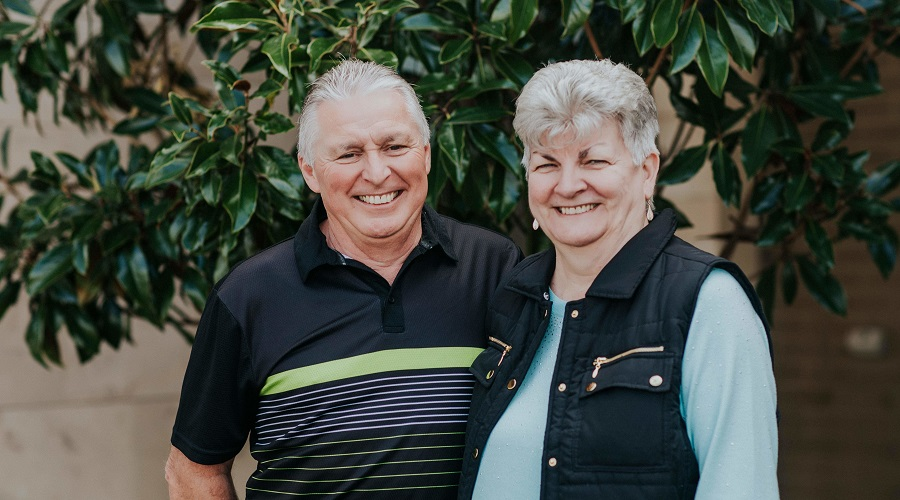 Residents Kelvin and Sue Shirley from Affinity Retirement Village smiling at camera