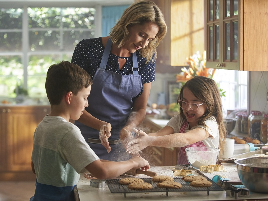 Mother baking Christmas goods with children