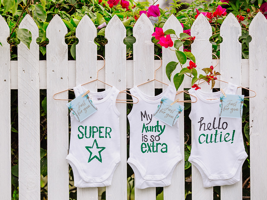 Baby Shower Onezies on a fence