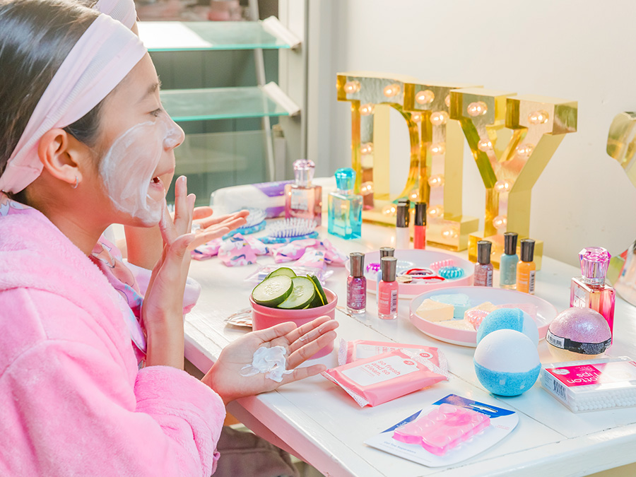 Young girl using beauty products